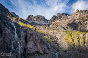 Waterfalls of glacial melt high above Yubeng Village