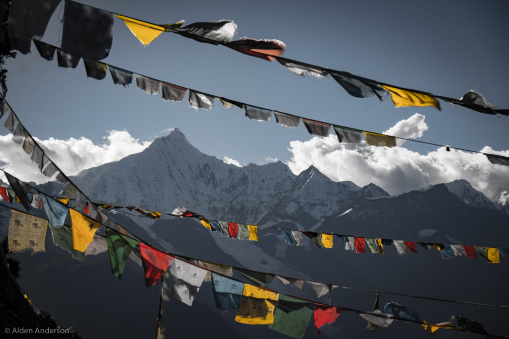 Kawagebo Peak through prayer flags