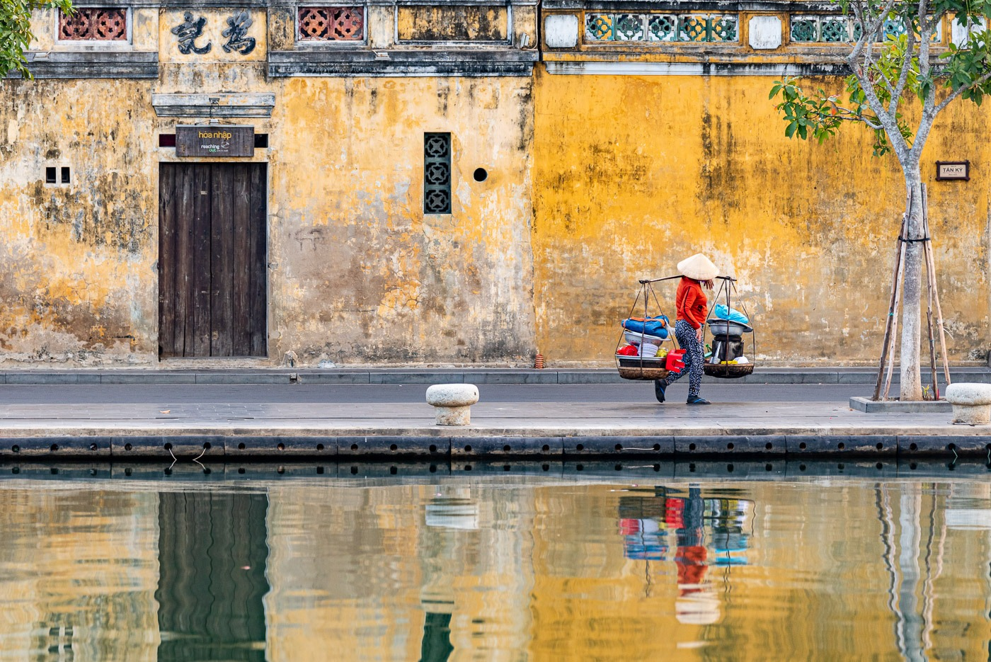 Hà, 44, on the way to the market in Hoi An, Vietnam